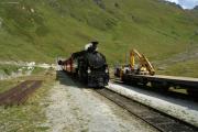 Dampfbahn Furka-Bergstrecke; Zug 155 mit HG 3/4 Nr.4 nach Oberwald erreicht die Stn. Muttbach-Belvédère; Portal des Scheiteltunnels