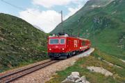 HGe 4/4 II 101 mit Glacier-Express oberhalb Nätschen. 1988