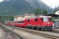 Ge 4/4 II 611 vor einem Bernina Express in Pontresina