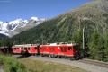 Gem 4/4 801 und ABe 4/4 44 in der Montebello-Kurve. Links Piz Bernina und Piz Morteratsch.