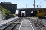 Einfahrt eines Bernina Express aus dem Süden in Ospizio Bernina