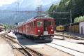 Bernina Express mit ABe 4/4 49 in Poschiavo. Rechts die Oldtimer ABe 4/4 30 und 34