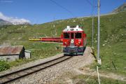 ABe 4/4 53 umrundet die Schleife im Val Bügliet am Lago Bianco kurz vor Ospizio Bernina.