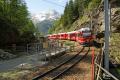 ABe 8/12 3502 beim Gletschergarten von Cavaglia.