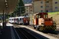 Die beiden ABe 4/4 51 und 52 bringen sich in Position für die Führung eines Bernina-Express. Der Tm 2/2 113 macht Pause. Pontresina.