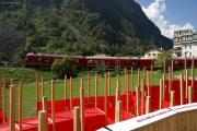 """""""Allegra"""" ABe 8/12 3504 mit einem Bernina-Express auf dem Karussell des Kreisviadukts von Brusio."""