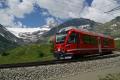 Allegra ABe 8/12 3513 verlässt Alp Grüm. Links oben der Palügletscher