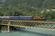 Ge 6/6 I 415 mit dem Alpine Classic Pullman auf der Rheinbrücke bei Reichenau