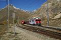 ABe 4/4 51 und 52 mit Zug 1633 in Bernina-Lagalb. Hinten der Piz Albris und das Val da Fain