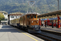 "Ge 4/4 182, ""Bernina-Krokodil"", mit zwei Pullman-Wagen in Tirano"