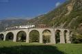 """Ge 4/4 182, """"Bernina-Krokodil"""", mit zwei Pullman-Wagen auf dem Kreis-Viadukt von Brusio"""